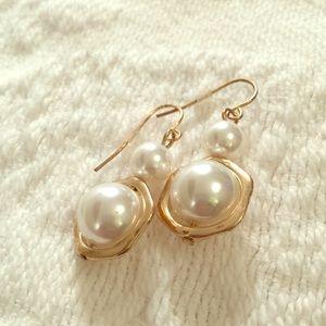 Pearl dangle earrings.
